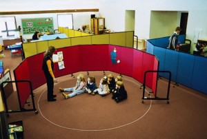 Four room dividers used to separate a daycare into smaller classrooms