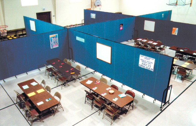 Using space efficiently by creating meeting rooms in a gym with room dividers