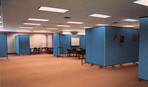 Instructional training rooms of any size or shape can be easily set up and changed at will with portable room dividers
