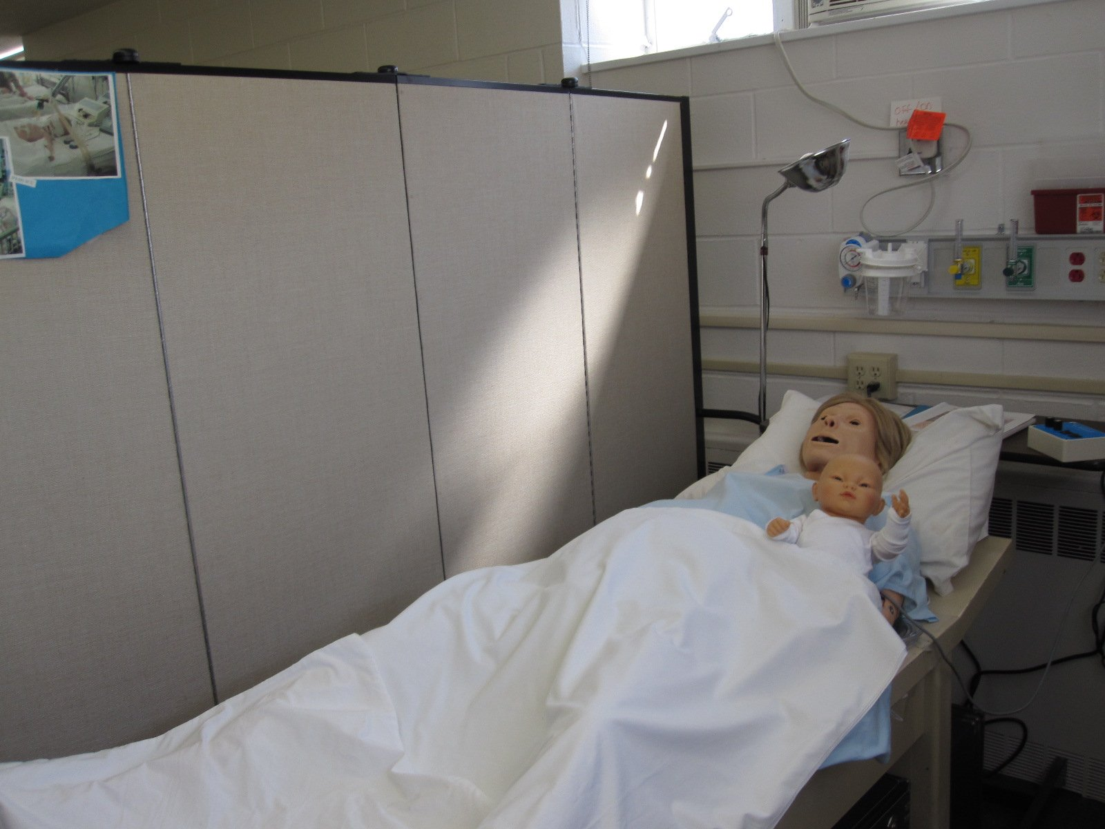 Nursing School Portable Screen Dividers separate simulated patients in a classroom