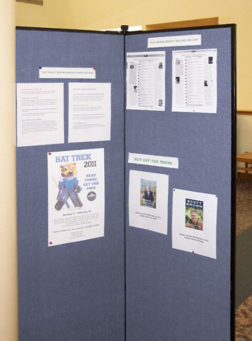 Tack items to a library display board