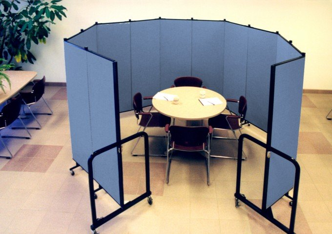 """Birds-eye view"" of versatile Portable Room Dividers set up in circular fashion around a round table"