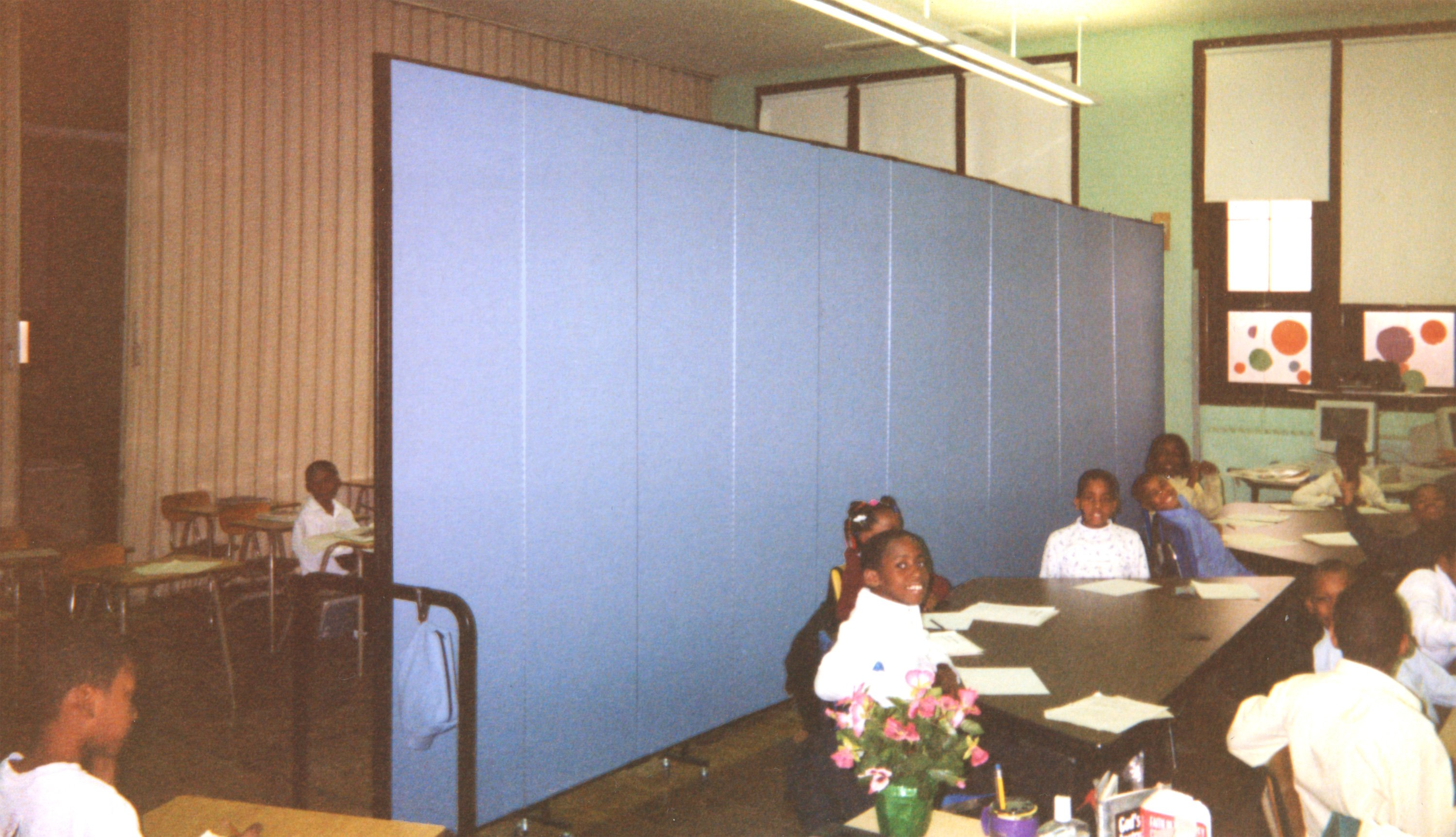 Acoustical Wallmount dividers help make the best use of space in overcrowded schools
