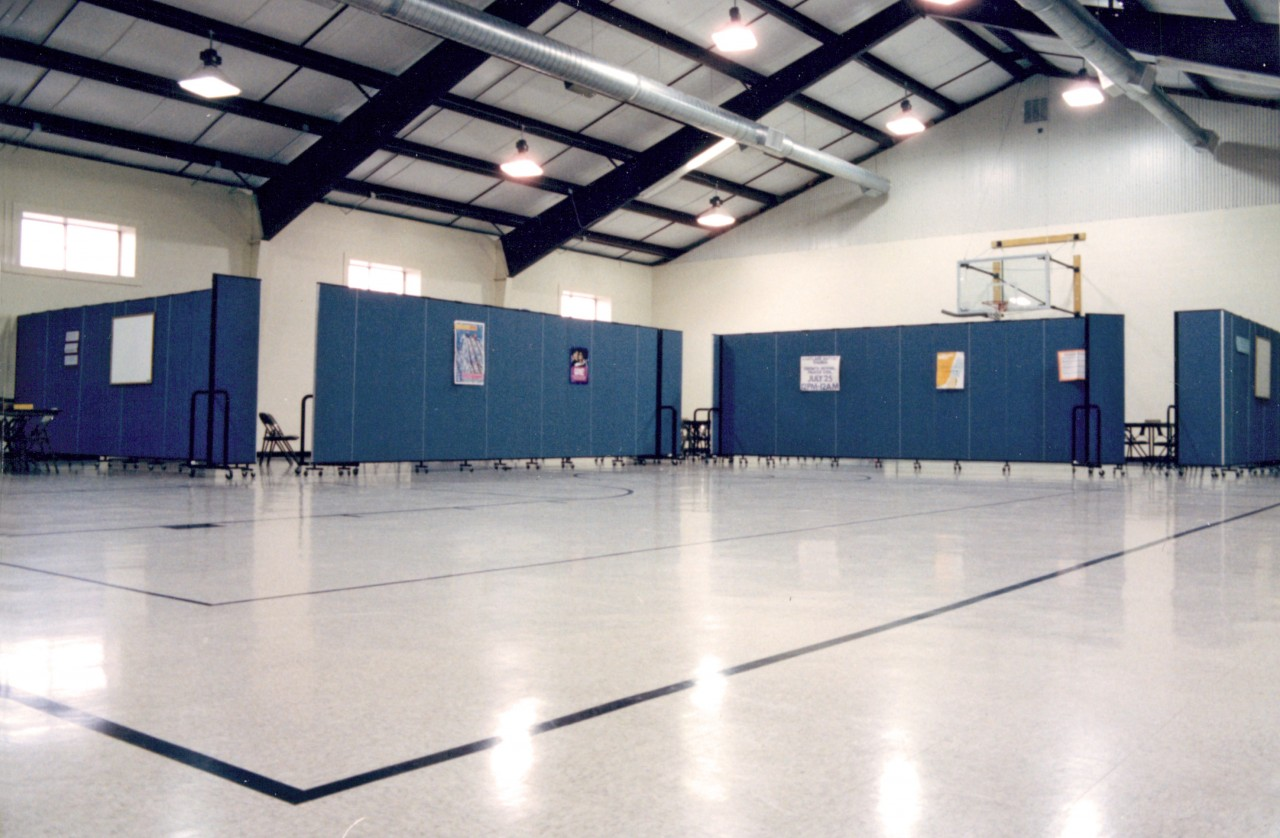 Even this cavernous gym can be easily subdivided for class or other use with acoustical portable walls