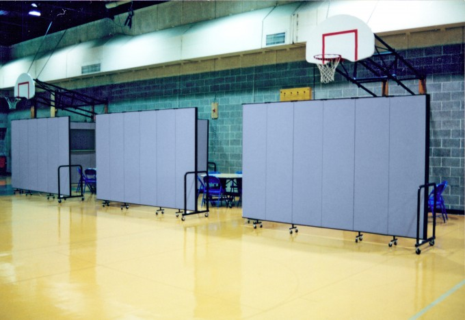 24 ft. long gymnasium dividers easily create rooms approximately 13 ft. by 11 ft