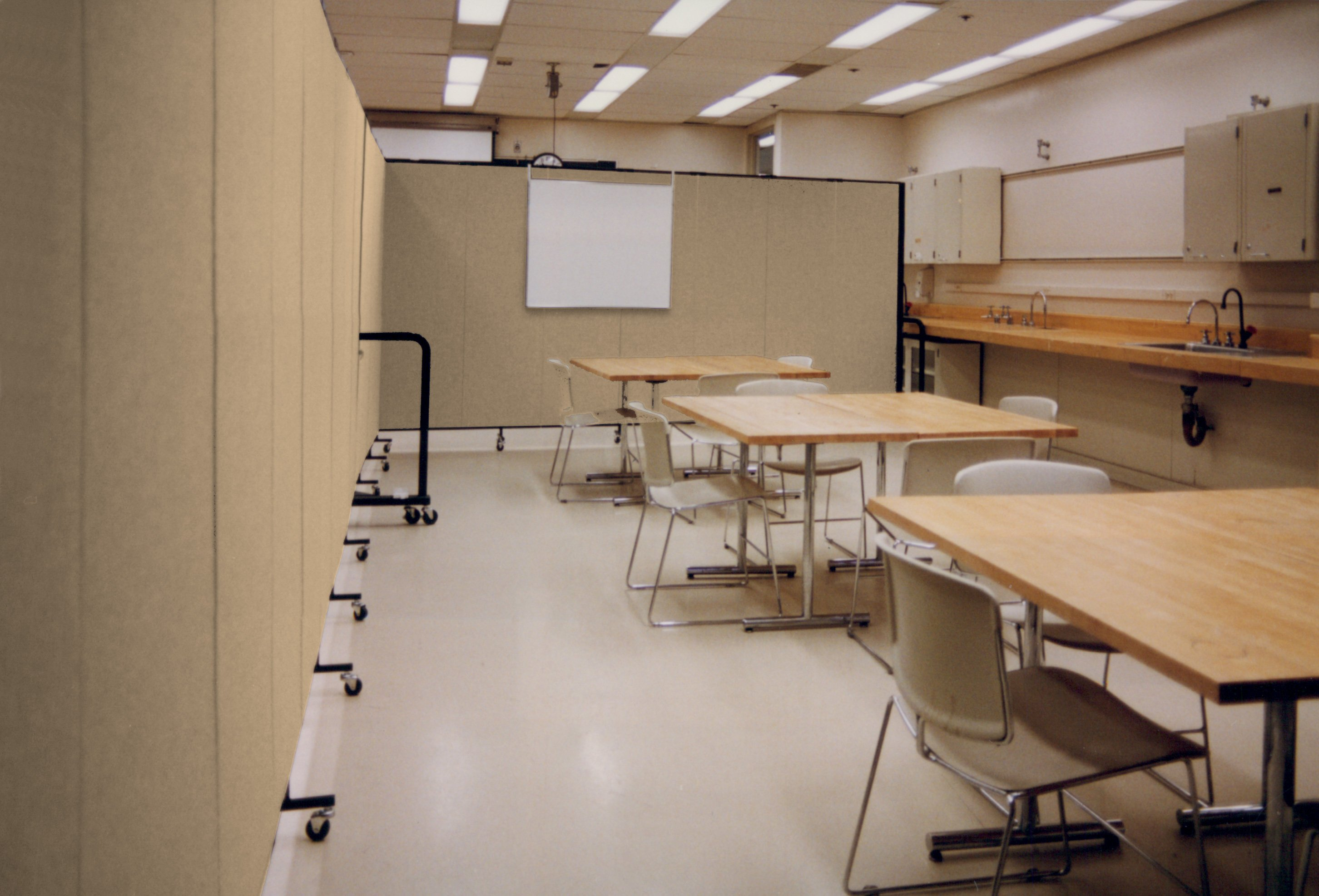 Acoustical dividers + markerboard + tables = classroom