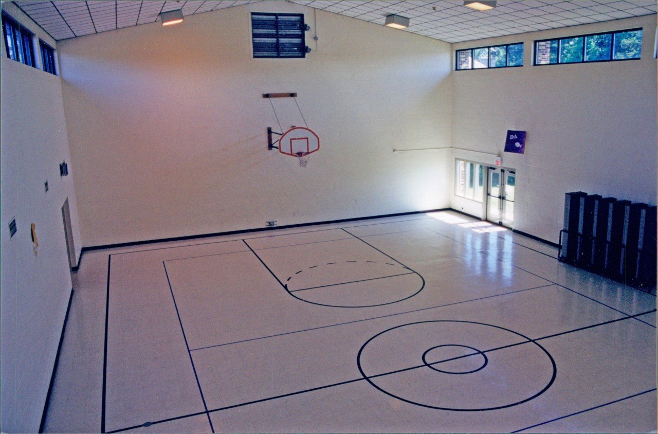 Open gym with six stored dividers on the side