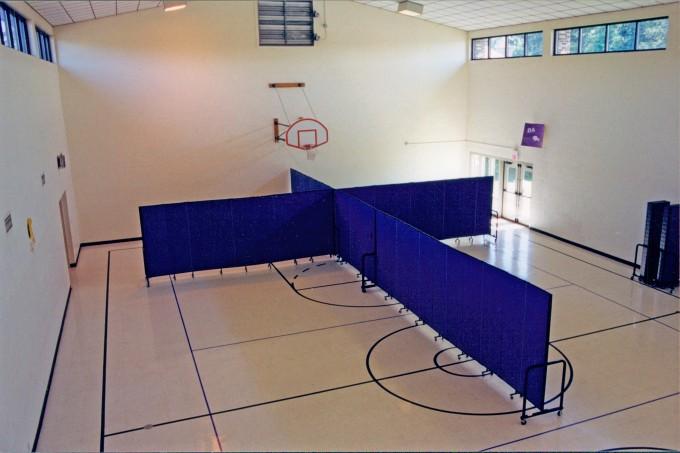multiple room dividers in a gym