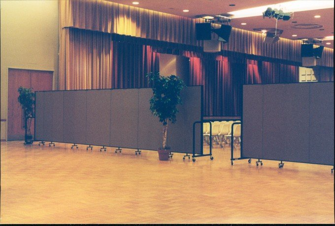 Portable dividers were easily rolled from the library to the auditorium to help create a more intimate setting for graduation