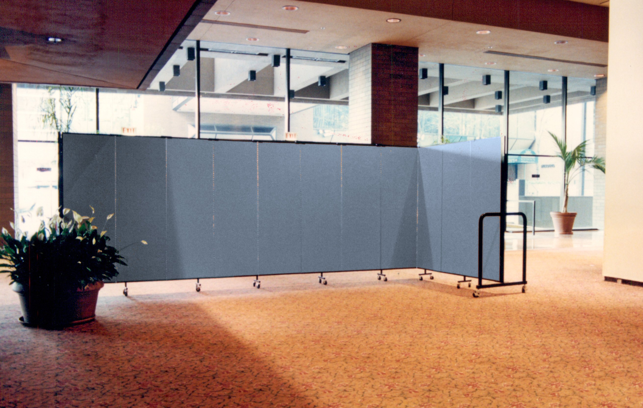 A room divider hides workers changing carpet in a hotel lobby
