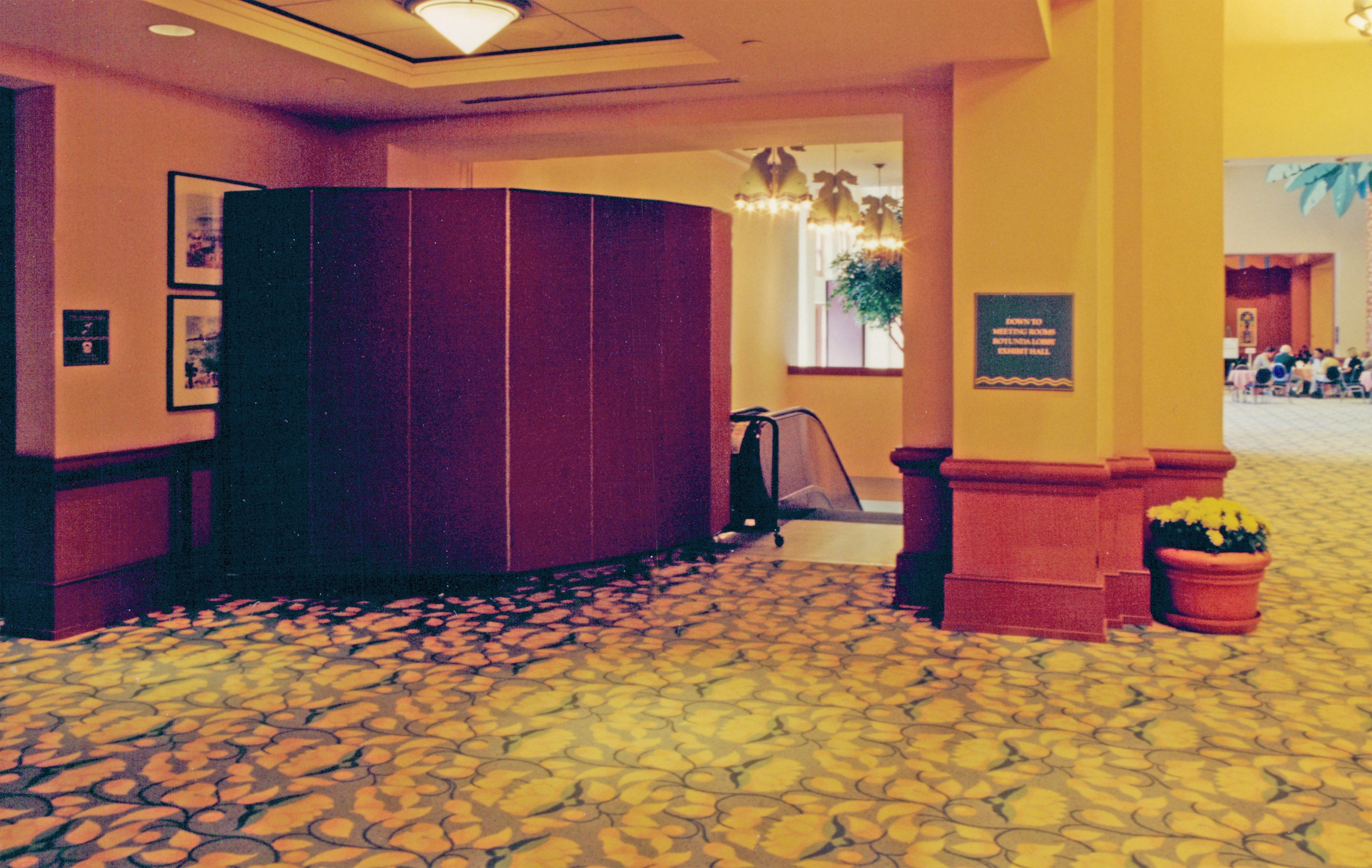 A room divider protects guests from using a escalator under repair