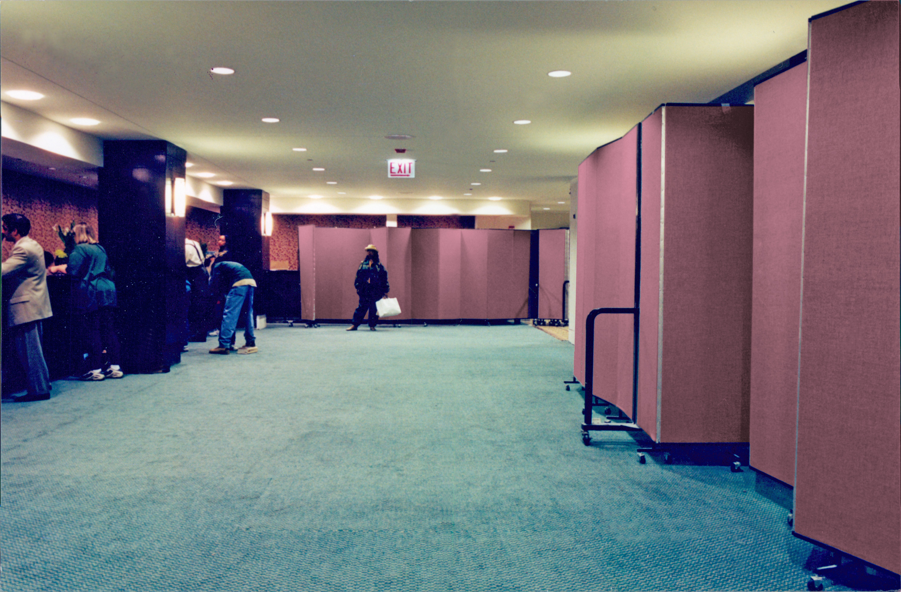 Portable partitions hide construction for hotel guests checking in