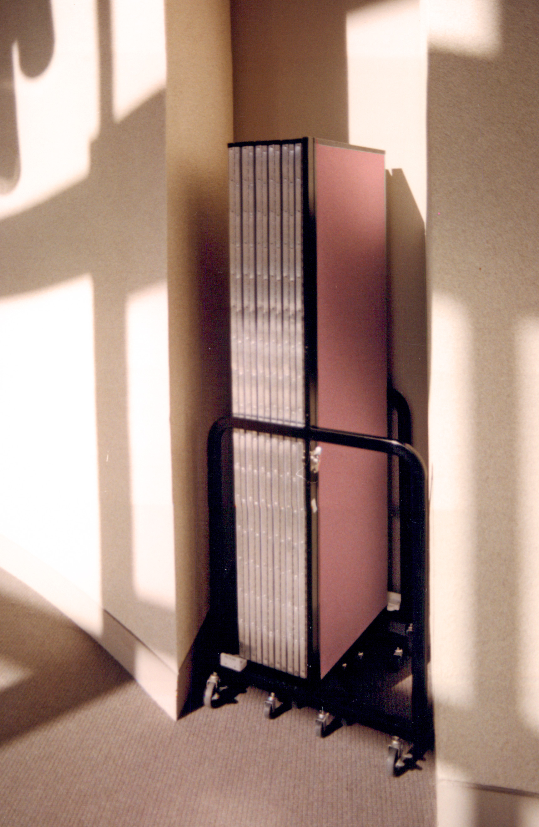 A closed room divider tucked away into a wall nook
