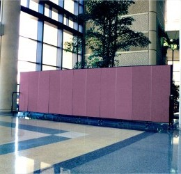 A portable room divider creates an lobby entryway for guests to enjoy