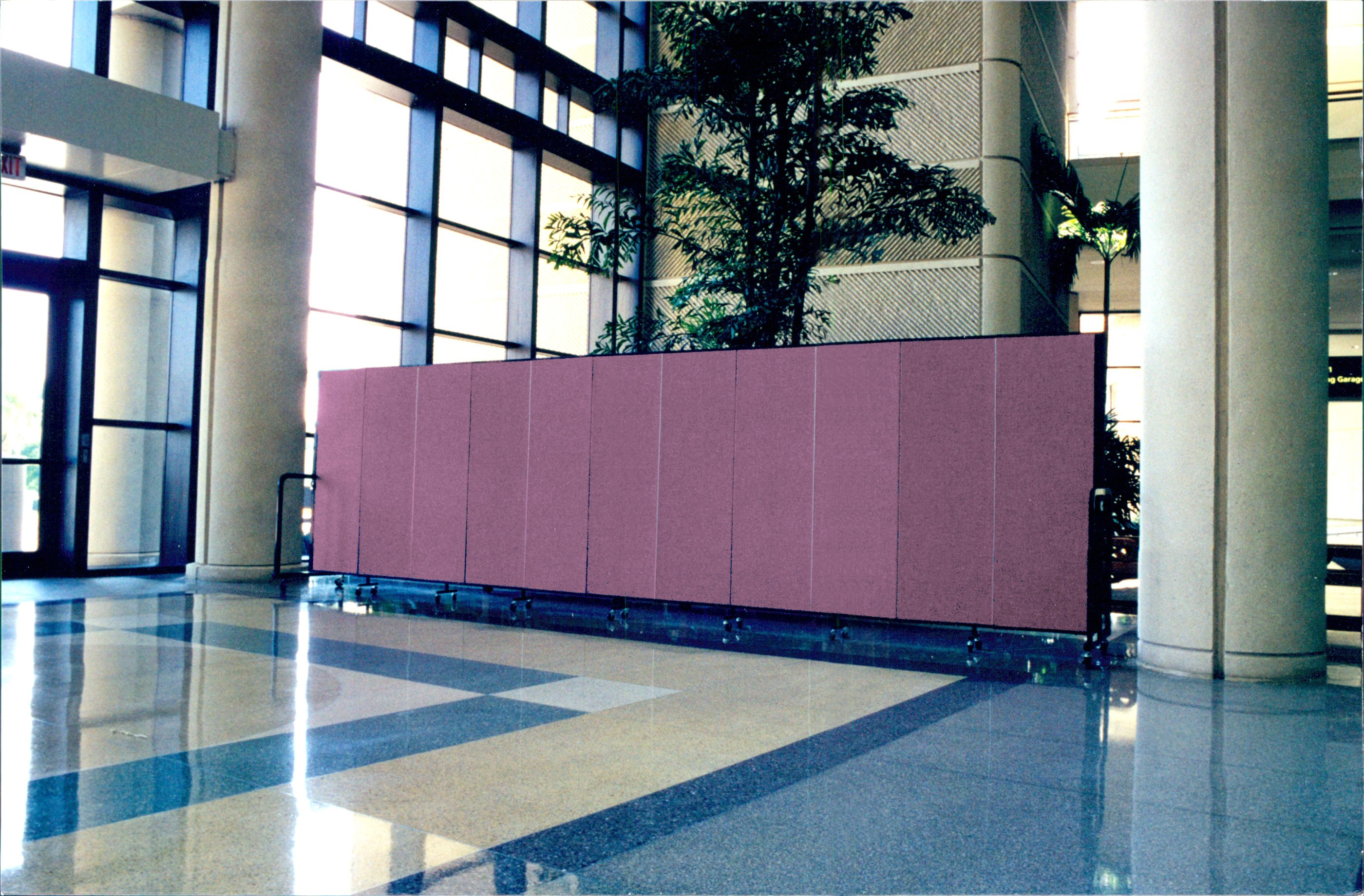 Freshly stained benches in a hotel lobby are totally out of view by rolling a portable wall into place
