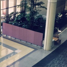 A room divider protects guests from a construction area in the hotel lobby