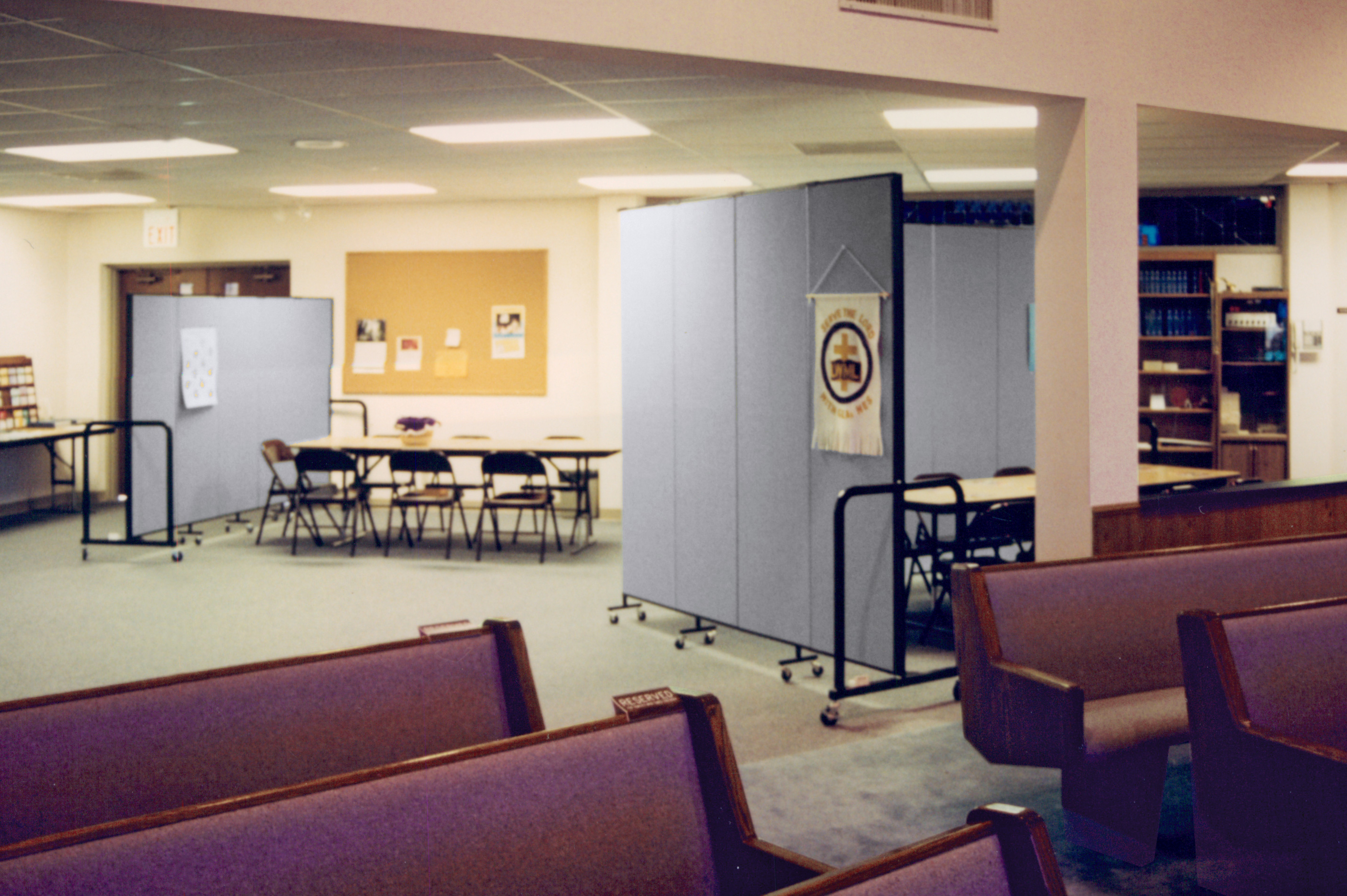 A room divider blocks an entrance to a church sanctuary in a basement room