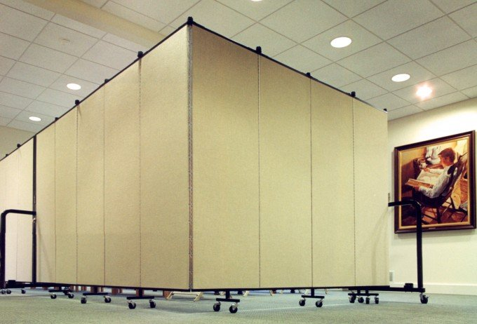 Two room divider walls connected to form one long wall in an L-shape