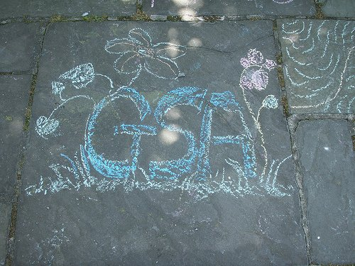 GSA written in chalk on a sidewalk
