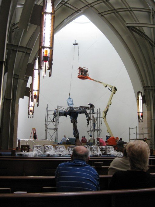 Christ on the Cross being raised into position