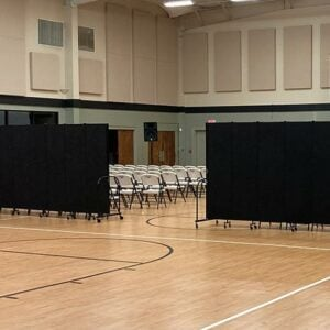 superior portable room dividers hiding chairs during a presentation