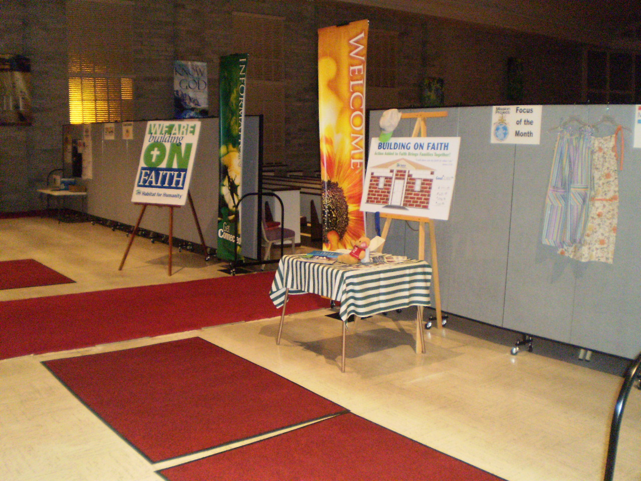 Church flyers and information are displayed on and around room dividers near the rear of a church