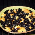 Blueberry Bread Pudding cooking in a bowl in the oven