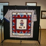 A boy sports themed handmade quilt