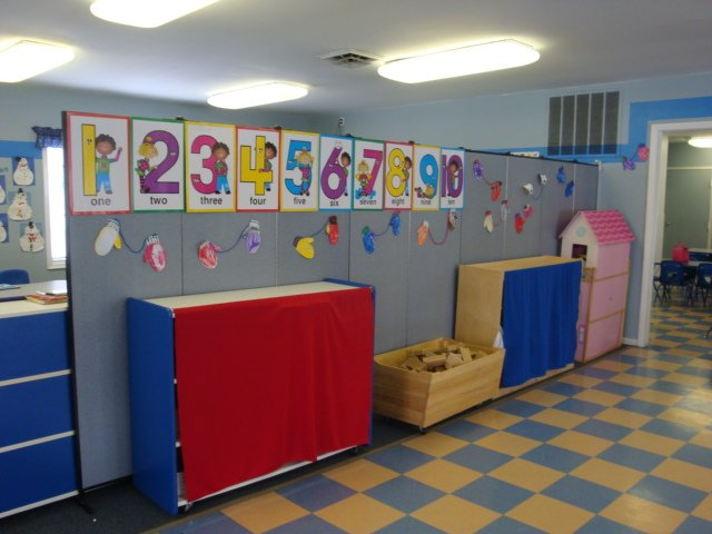 Temporary room dividers dividing space in a day care facility