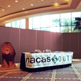Registration table for the nacas conference in a hotel lobby