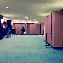 Screenflex Room Dividers create a barrier between guest check in and construction in a hotel lobby