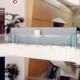To easily block access to one of the stairways, a Screenflex Portable wall was rolled into place