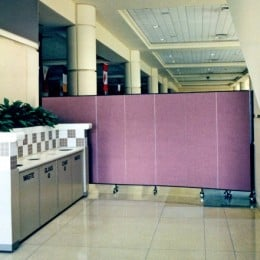 A room divider separates a cleaning crew from a convention area