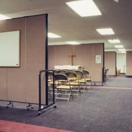 Room dividers are arranged to create Sunday School Classrooms in a church basement