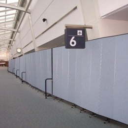 Hundreds of feet of dividers are locked together at JFK Airport.  This allows passengers to leave the plane during a ground stop without entering the general population of air travelers