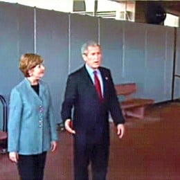 A wall of Screenflex Room Dividers creates a barrier for President and First Lady George W. Bush at the Walter Reed Medical Center
