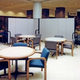 A room divider divides a seating area and a hallway in a student union