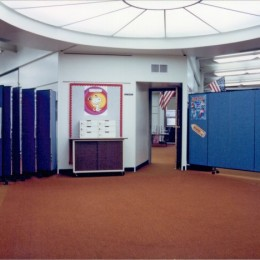 Wall mounted room dividers divide open areas in a school from the classrooms