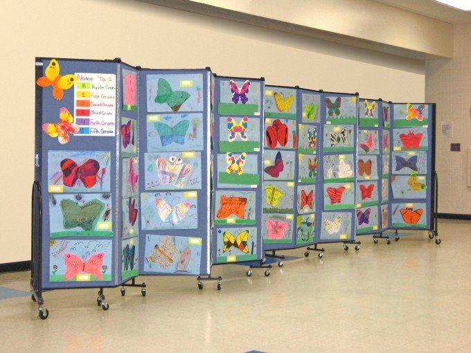 Art displays on movable walls