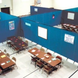 Screenflex Room Dividers are arranged to create 6 rooms in a gymnasium