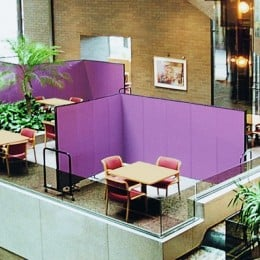 Room dividers create private meeting areas in a hotel lobby
