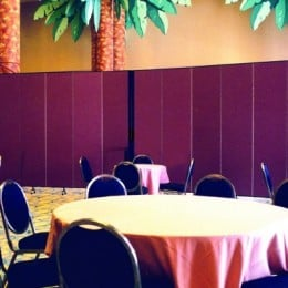 Room Divider separates round tables and chairs from tropical decorations