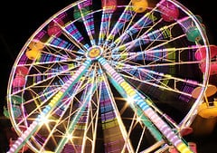 The vibrant colors of a ferris wheel in motion