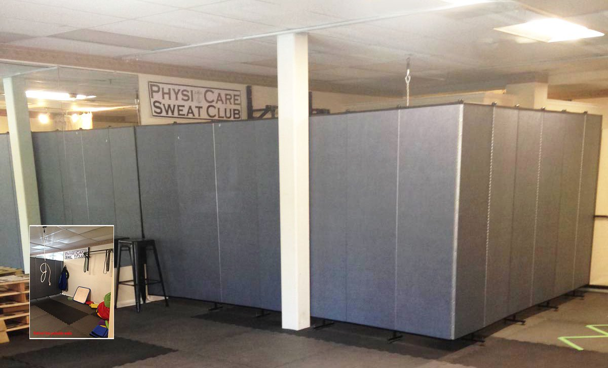 An aquatics and wellness center creates privacy for their therapy space with the help of Screenflex Room Dividers.