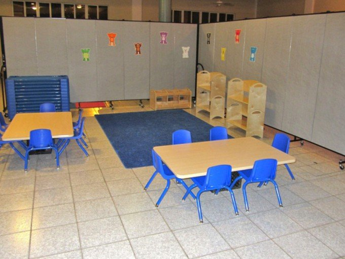 Classroom partition in an L-shape creates a separate daycare room in a church basement
