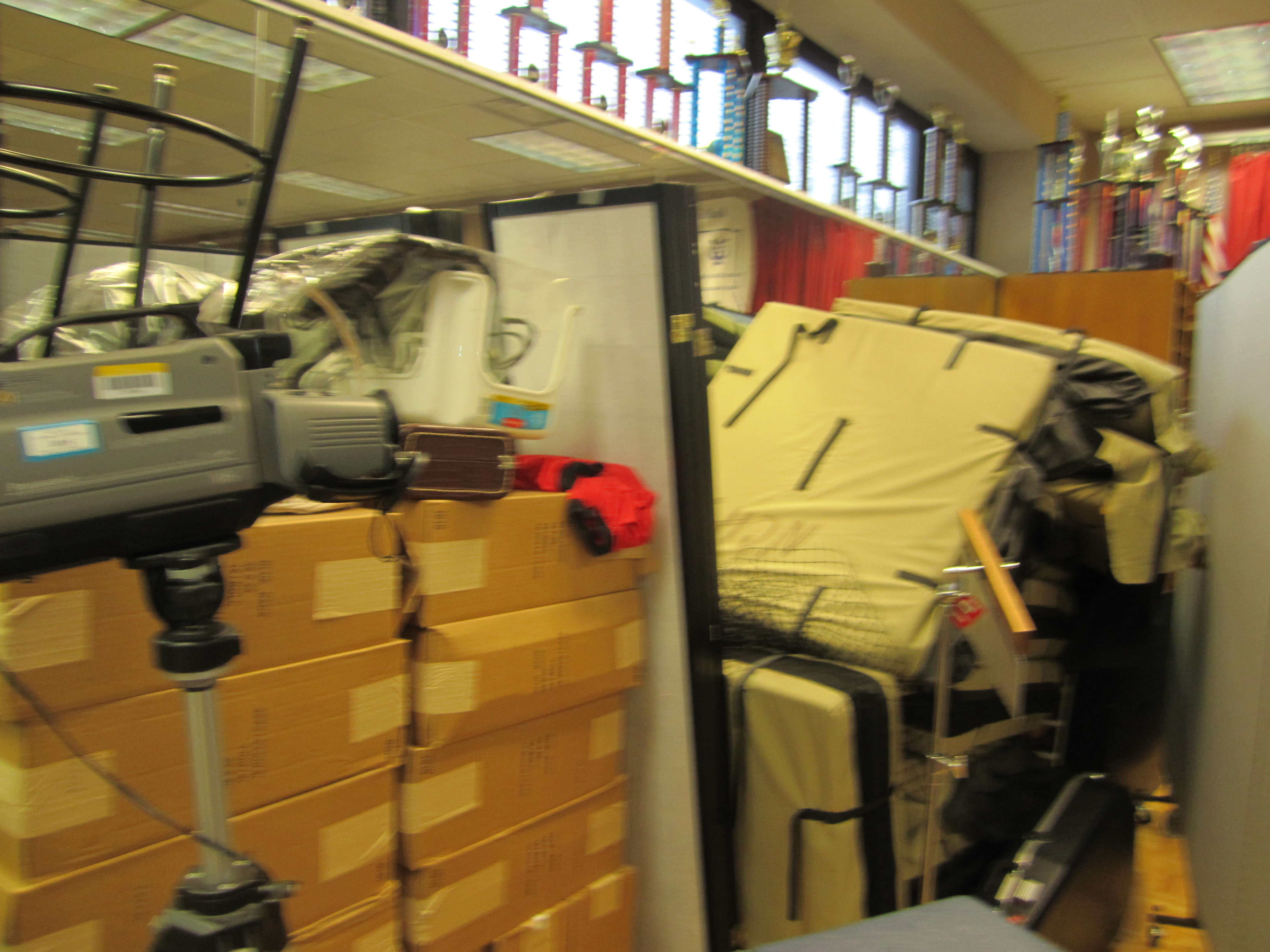 Room dividers hide storage area in a school office