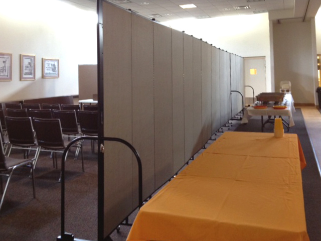Room dividers separate conference room from eating area