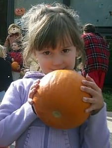 girls with pumpkin