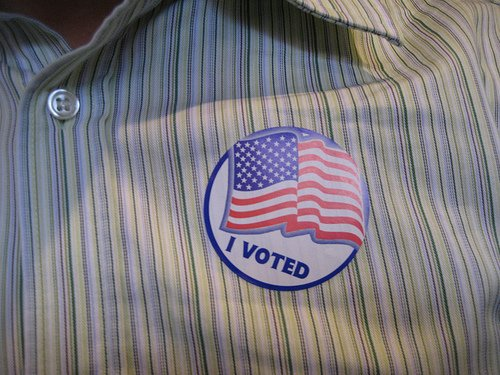 I voted sticker on a men's dress shirt
