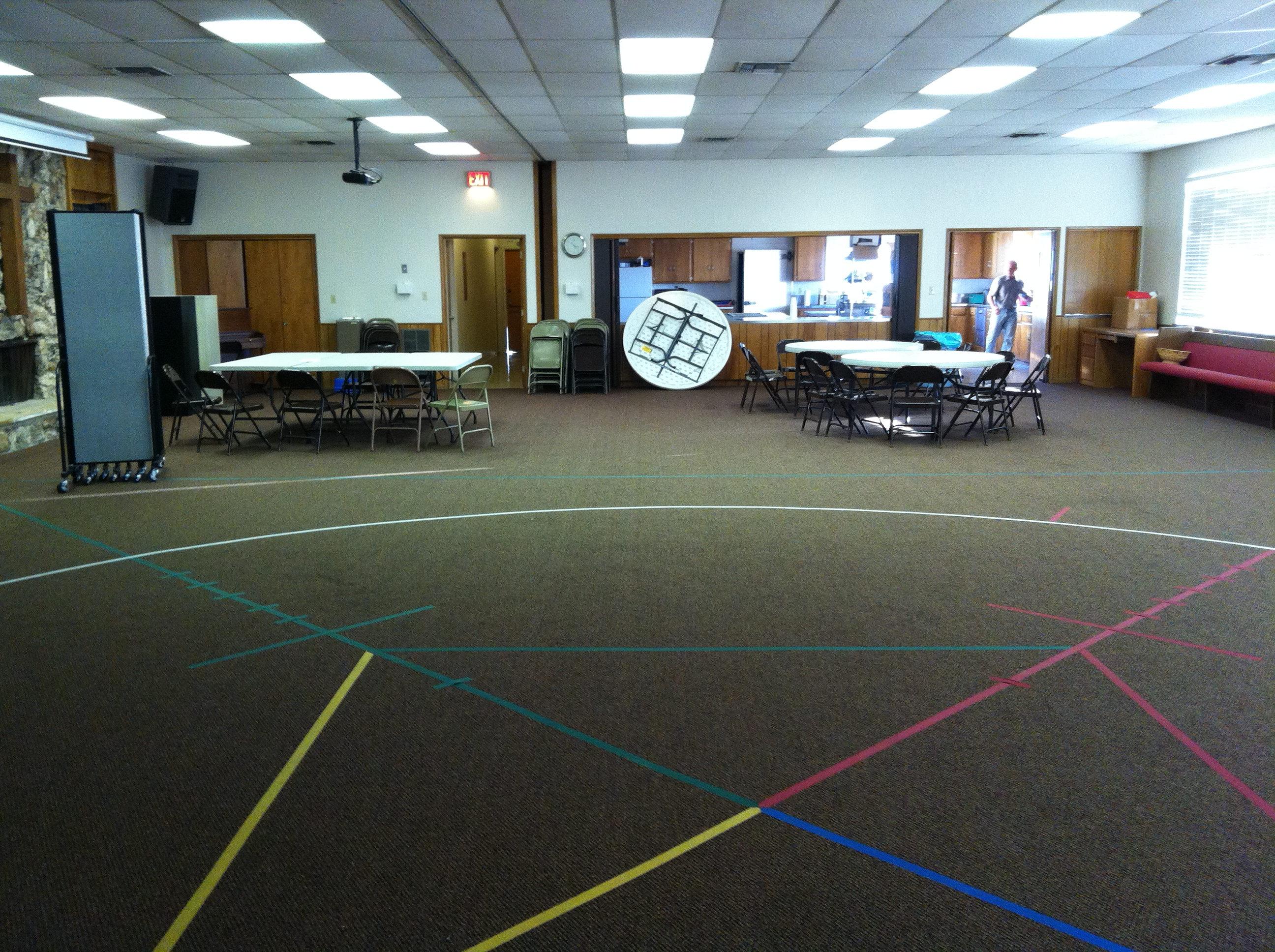 Awana circle taped to the carpet of a church multi purpose room